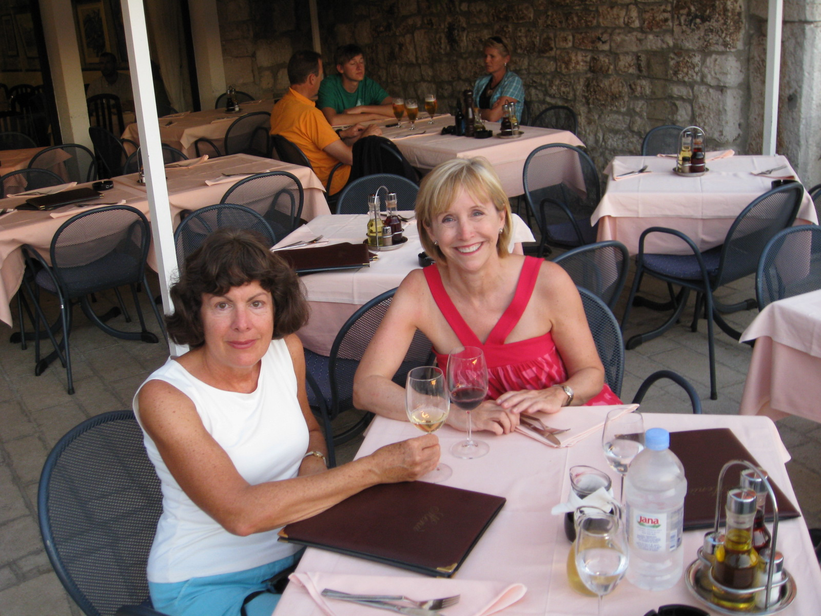 2 women eating outside in Rovinj, Croatia