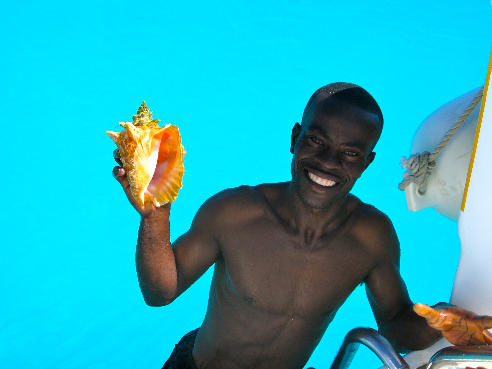Man with conch shell in Turks and Caicos