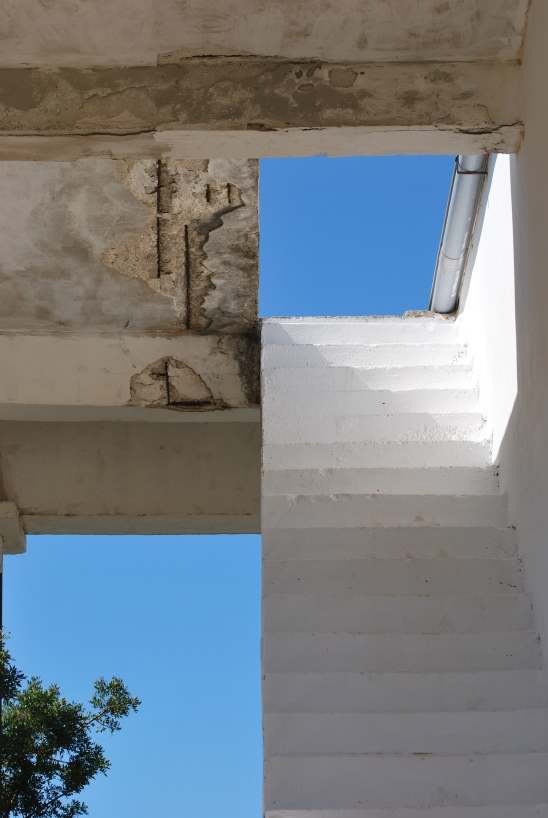 White stairs leading to blue sky