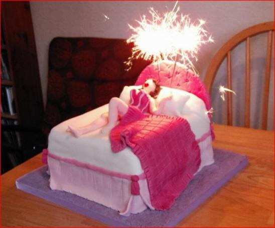Funny sexy woman in bed birthday cake