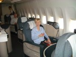 Woman riding in first class to Hong Kong