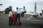 Small private plane being refueled in Indonesia