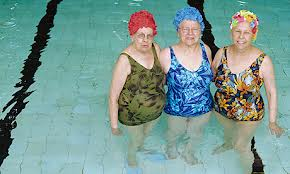 3 older ladies standing in a swimming pool in Florida