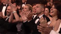 People giving a standing ovation