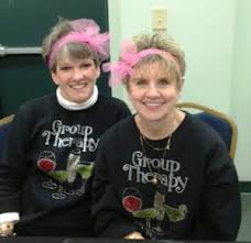 "Two women wearing sweatshirts that say ""Group Therapy"""