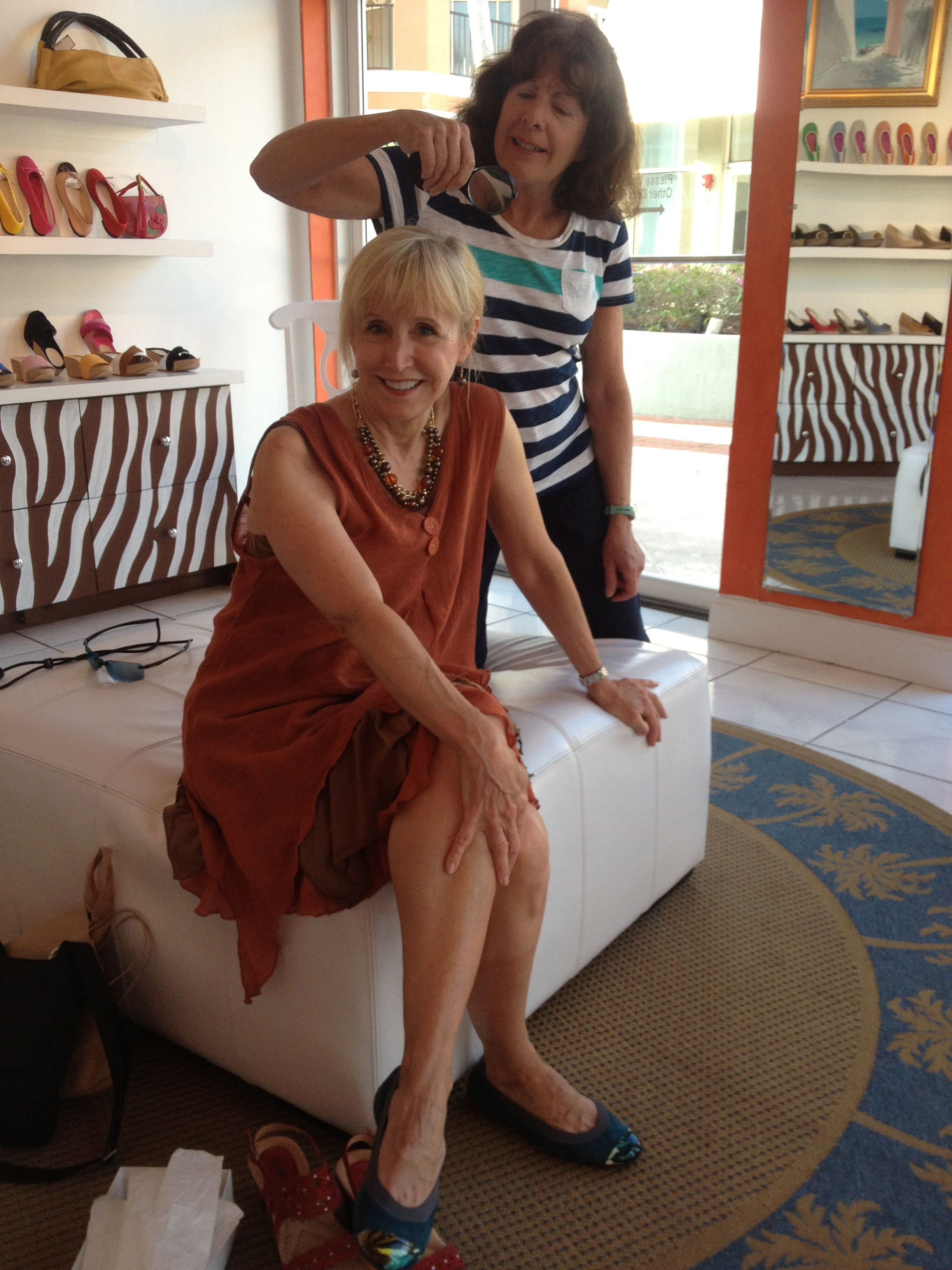 Blonde woman and brunette woman in shoe store in Florida