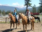 two women on horses in Jasper Park, Canada