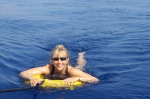bl;onde woman in inner tube in Ionian Sea off of Grece
