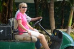 A woman sitting on a golf cart on Antigua