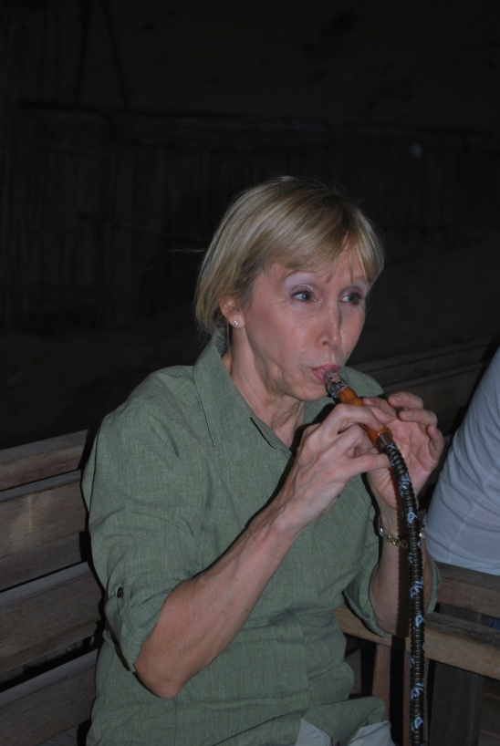 Blonde woman smoking a hookah