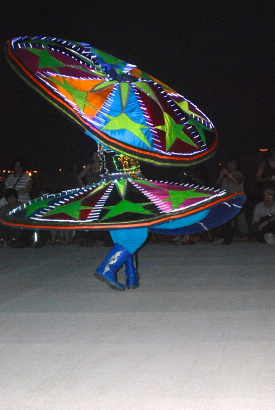 Tanoura dancer in desert outside of Dubai