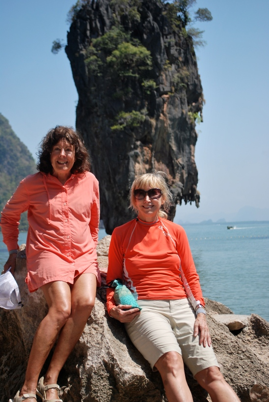 Brunette woman and blonde woman at James Bond Island in Phuket, Thailand