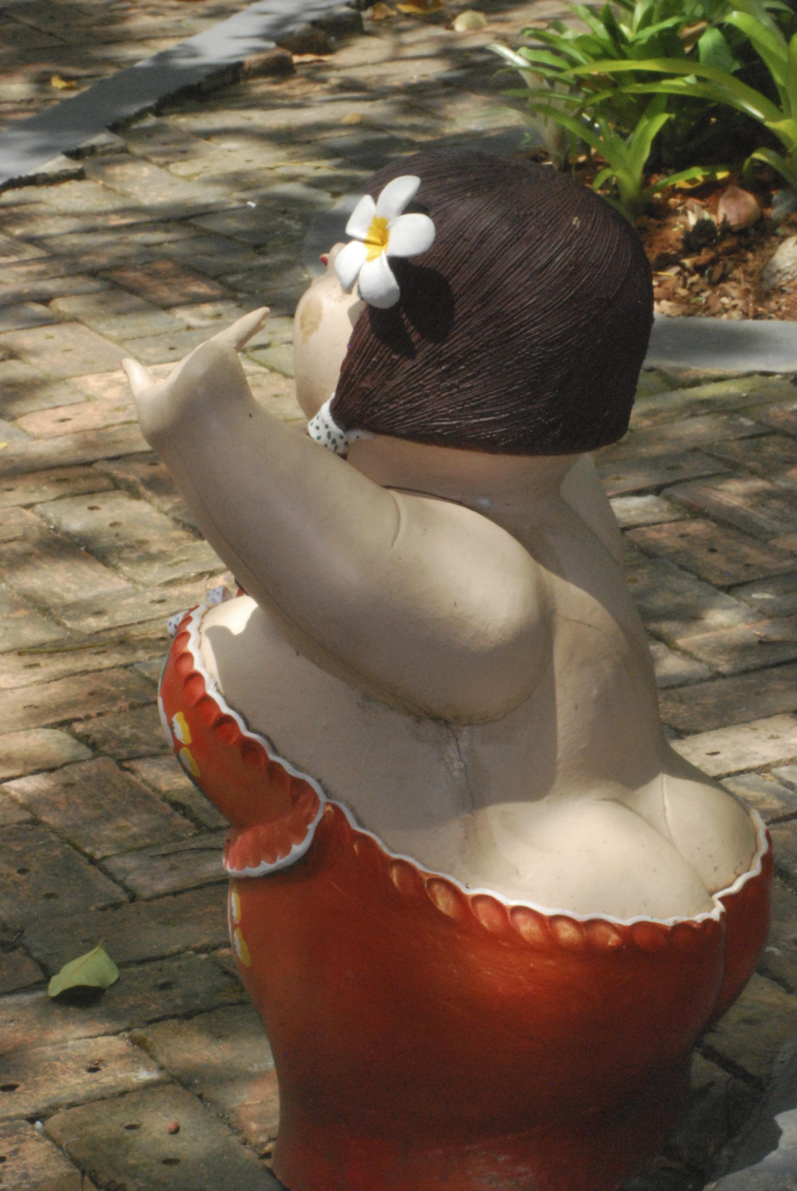 Brunette woman statue in Phuket Botanic Garden
