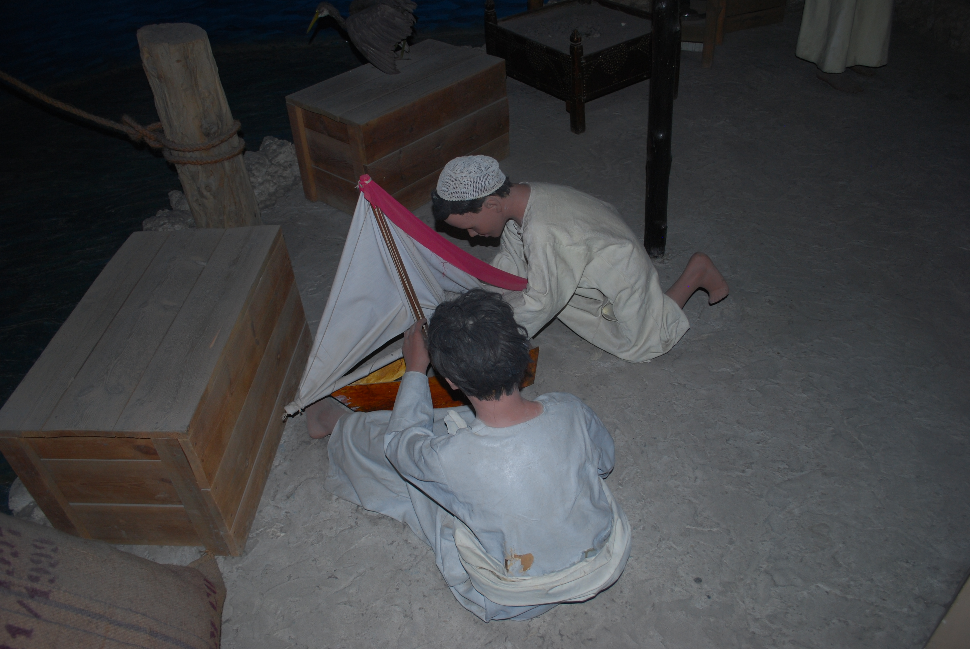 wo little boys building a to boat in the Dubai Museum