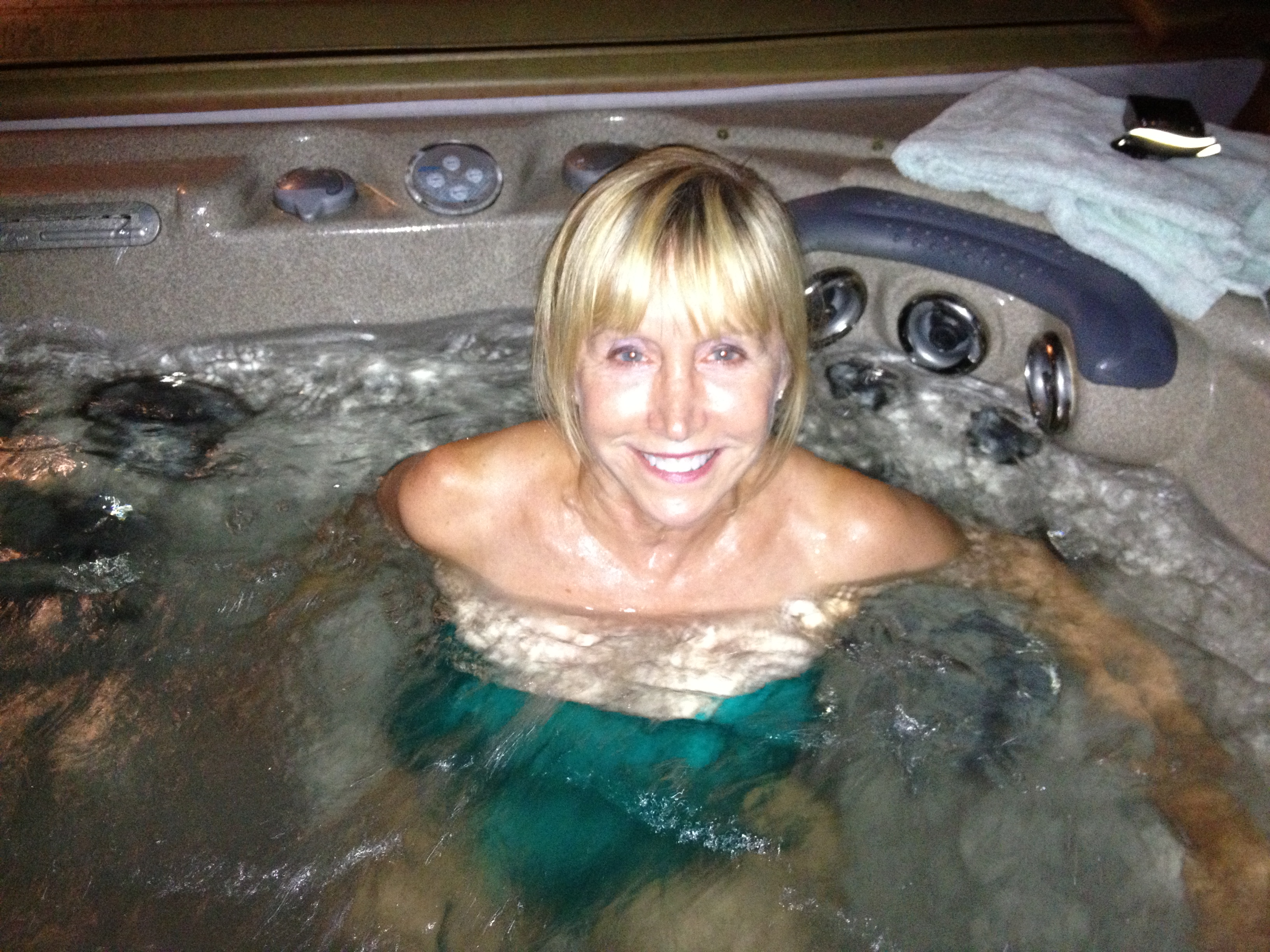 Blonde woman in hot tub