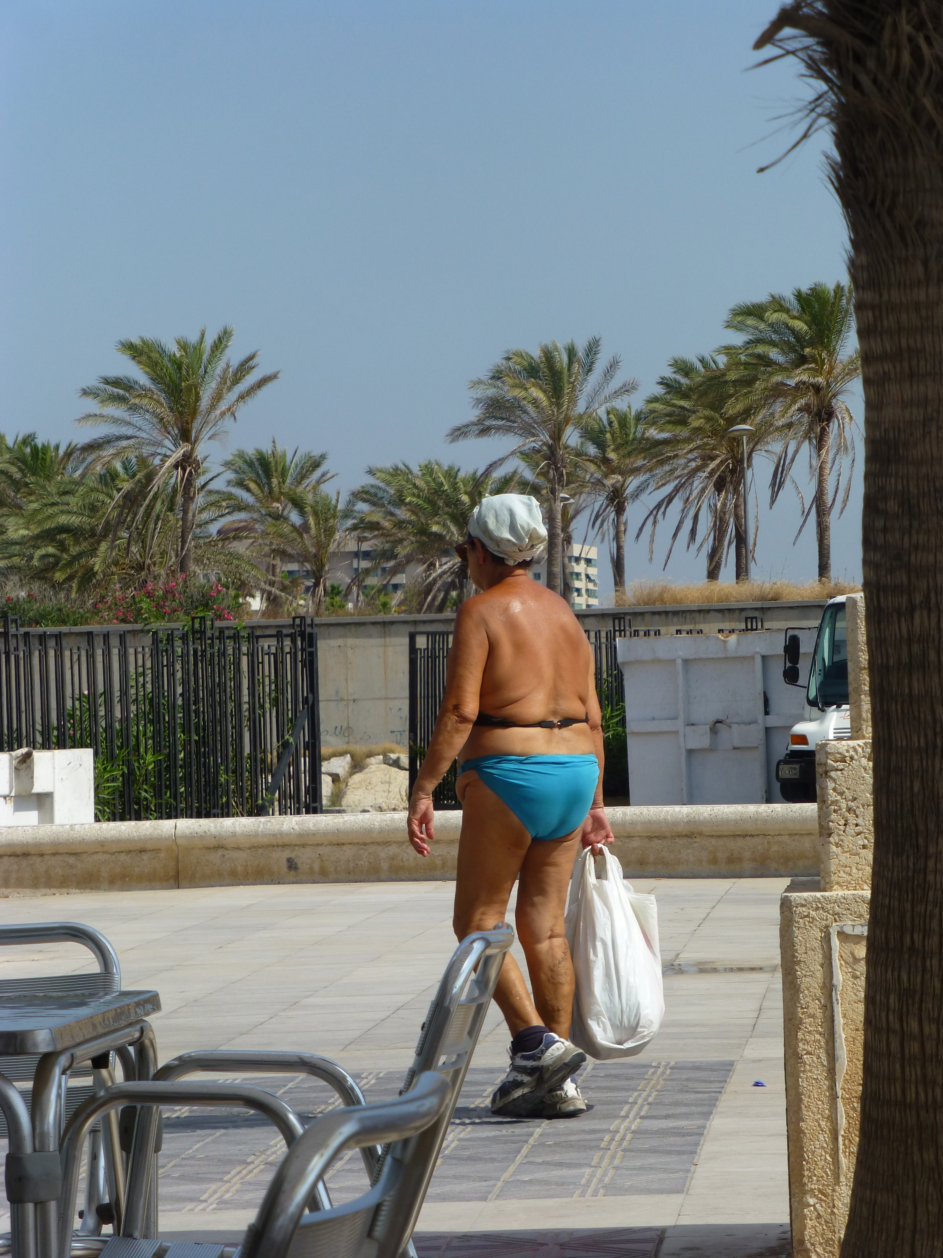 Older woman in topless bathing suit