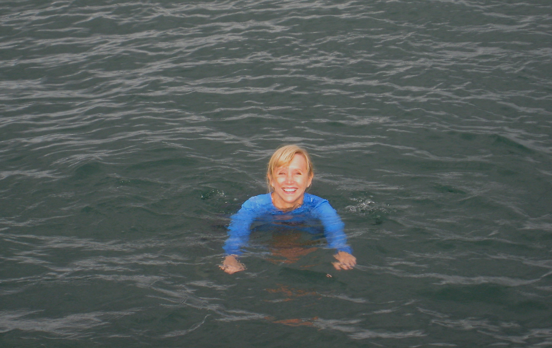 Blonde woman swimming at The Forty Foot Club in Ireland