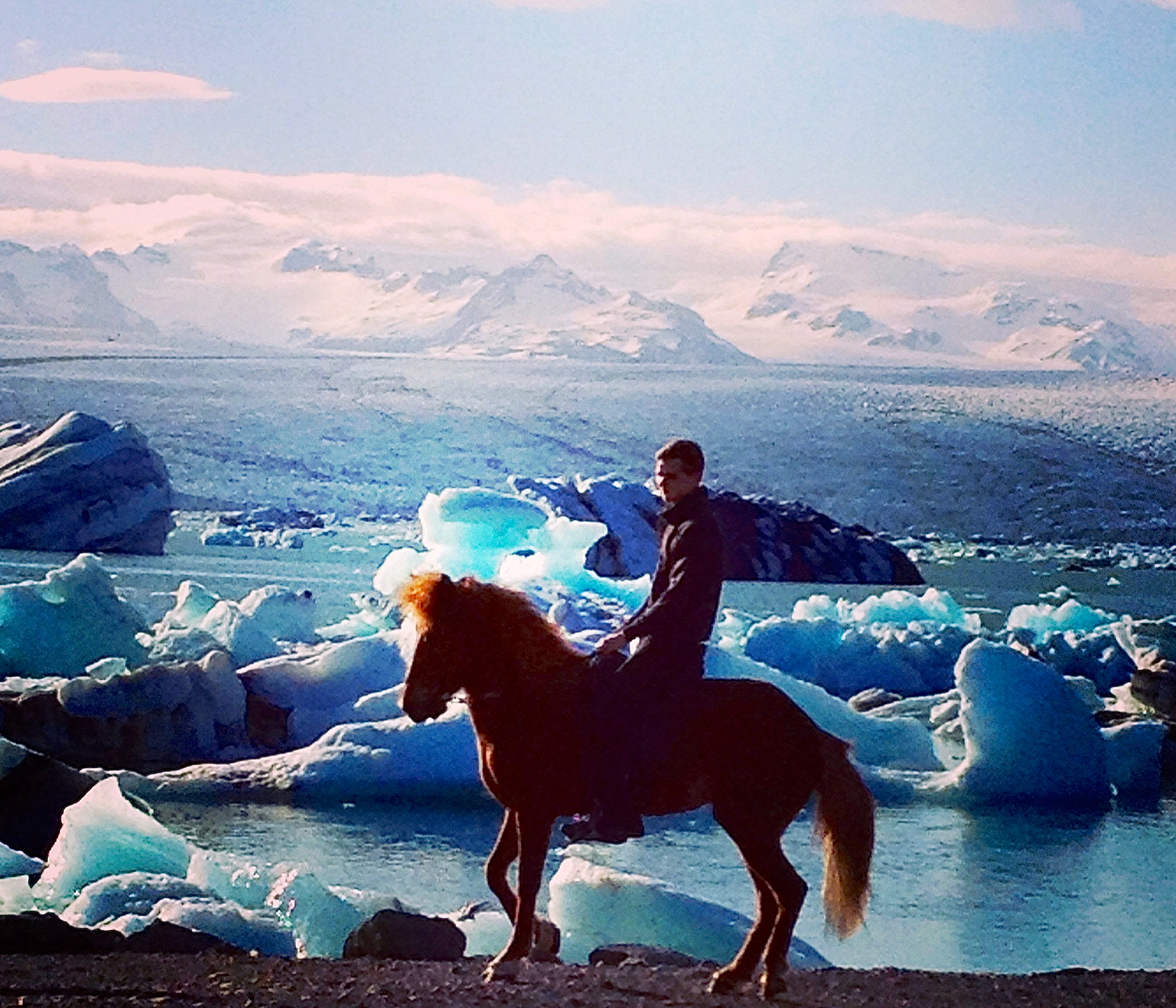 Man on horse at Jokulsarlon Lagoon in Iceland