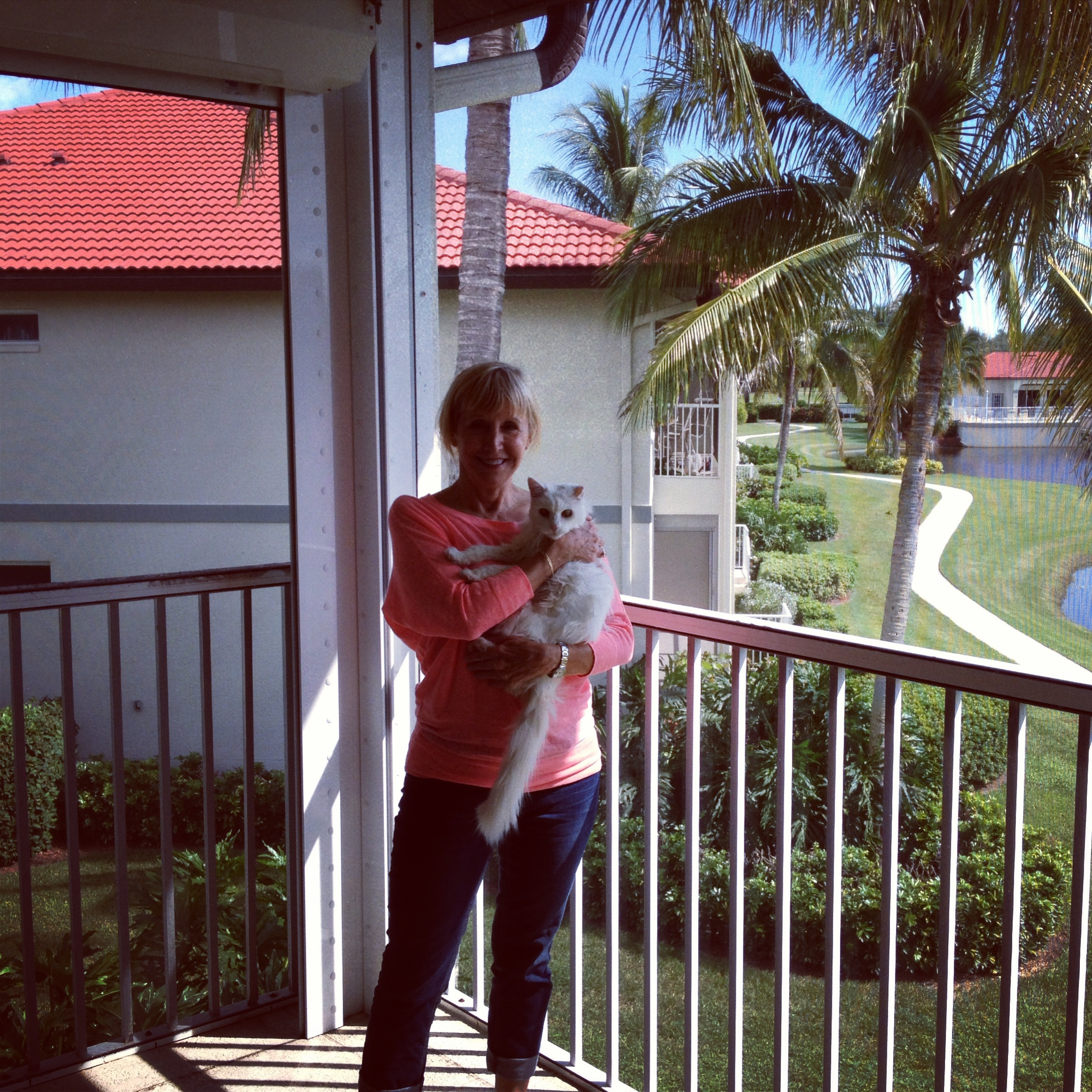 Blonde woman and cat on lanai in Marco Island Florida
