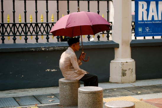 Man with umbrella in Singapore