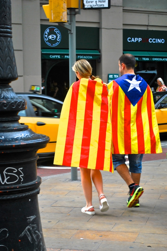 Catalan Independence Day flags on pedestrians