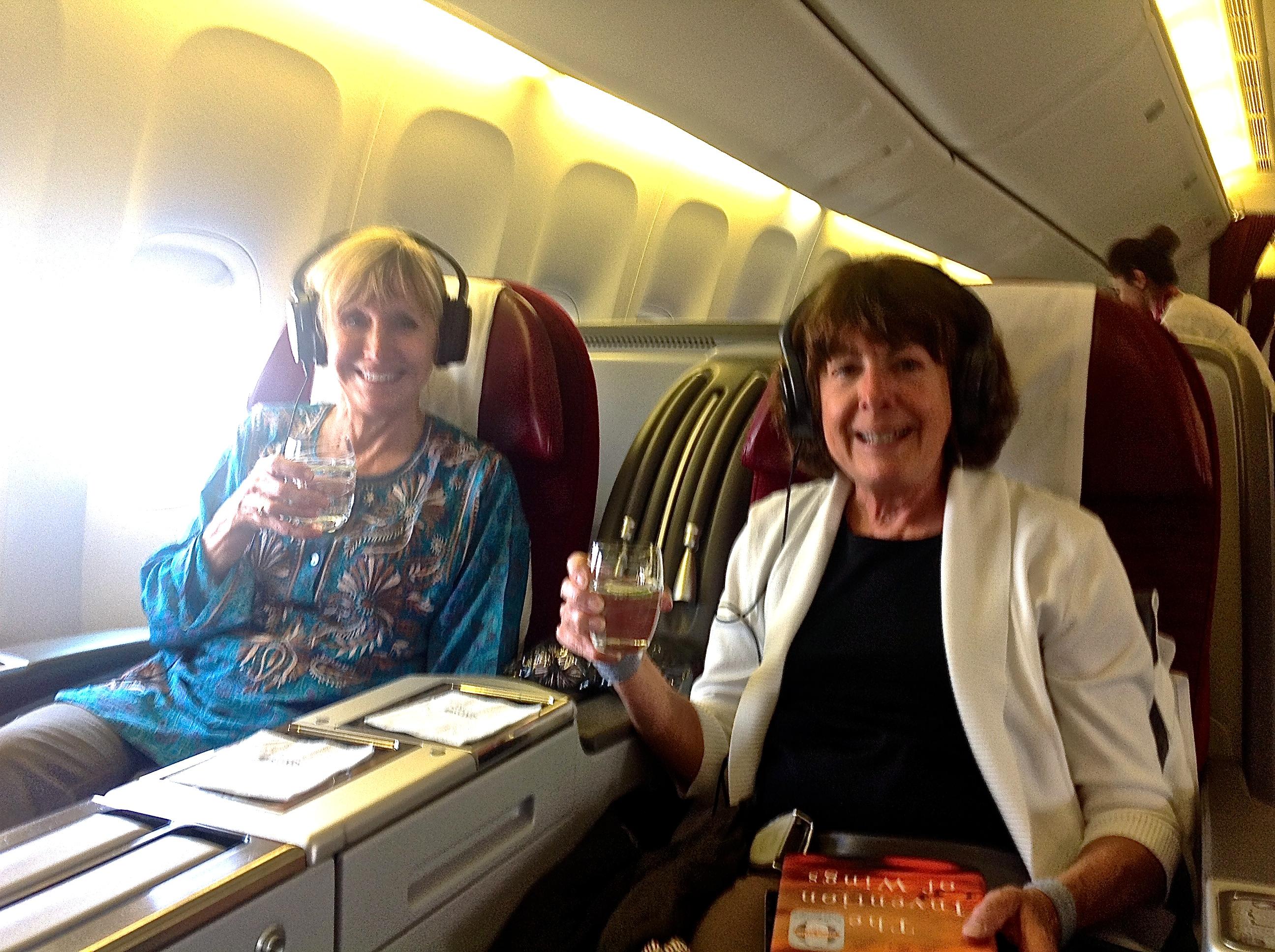 Two women in Qatar Airways Business Class