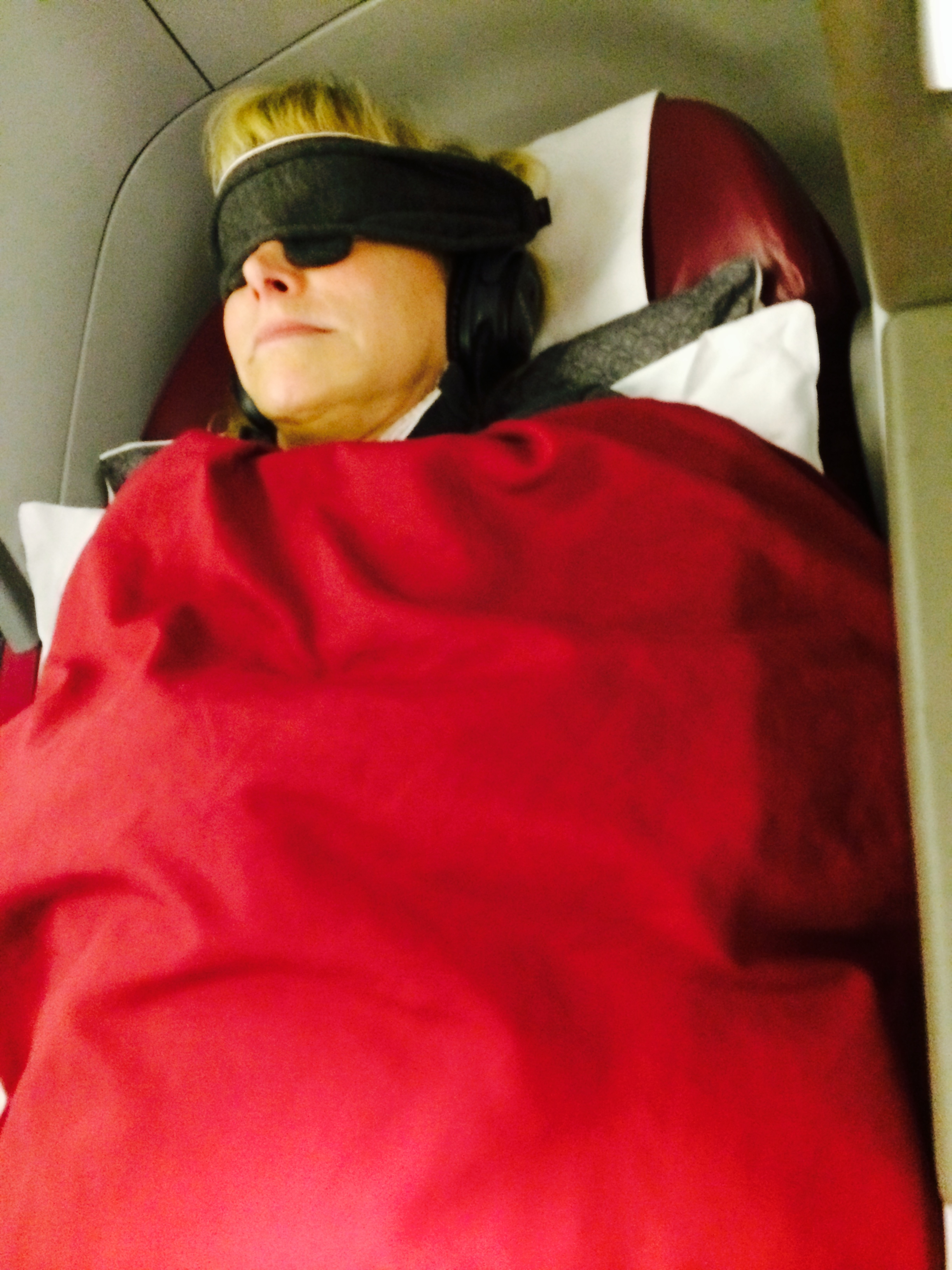 Woman sleeping in Business Class