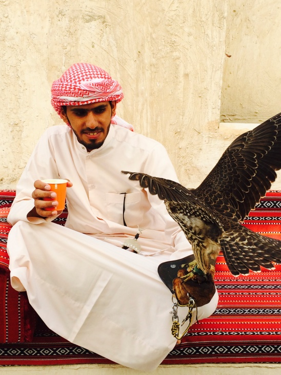 Man holding a falcon in Souq Waqif in Doha, Qatar