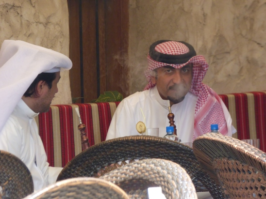 Men smoking shish as in Souk Waqif in Doha
