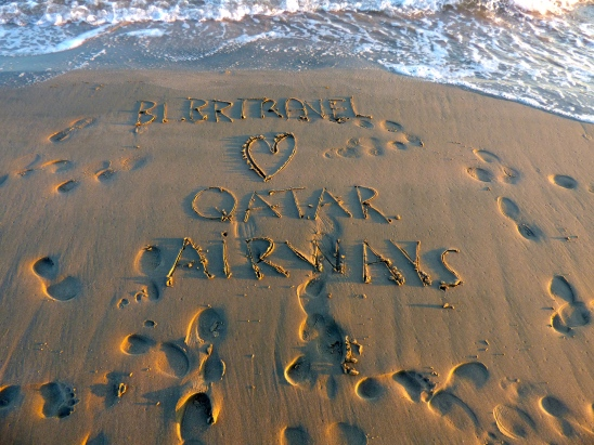 BlBrTrave loves Qatar Airways written in the sand