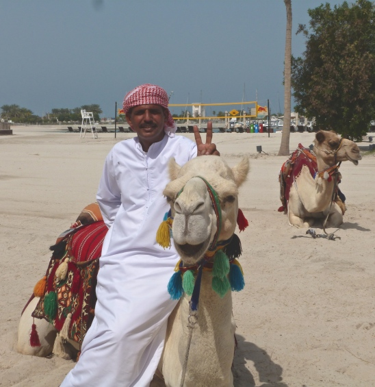 Bedouin man on camel at Emirates Palace, Abu Dhabi