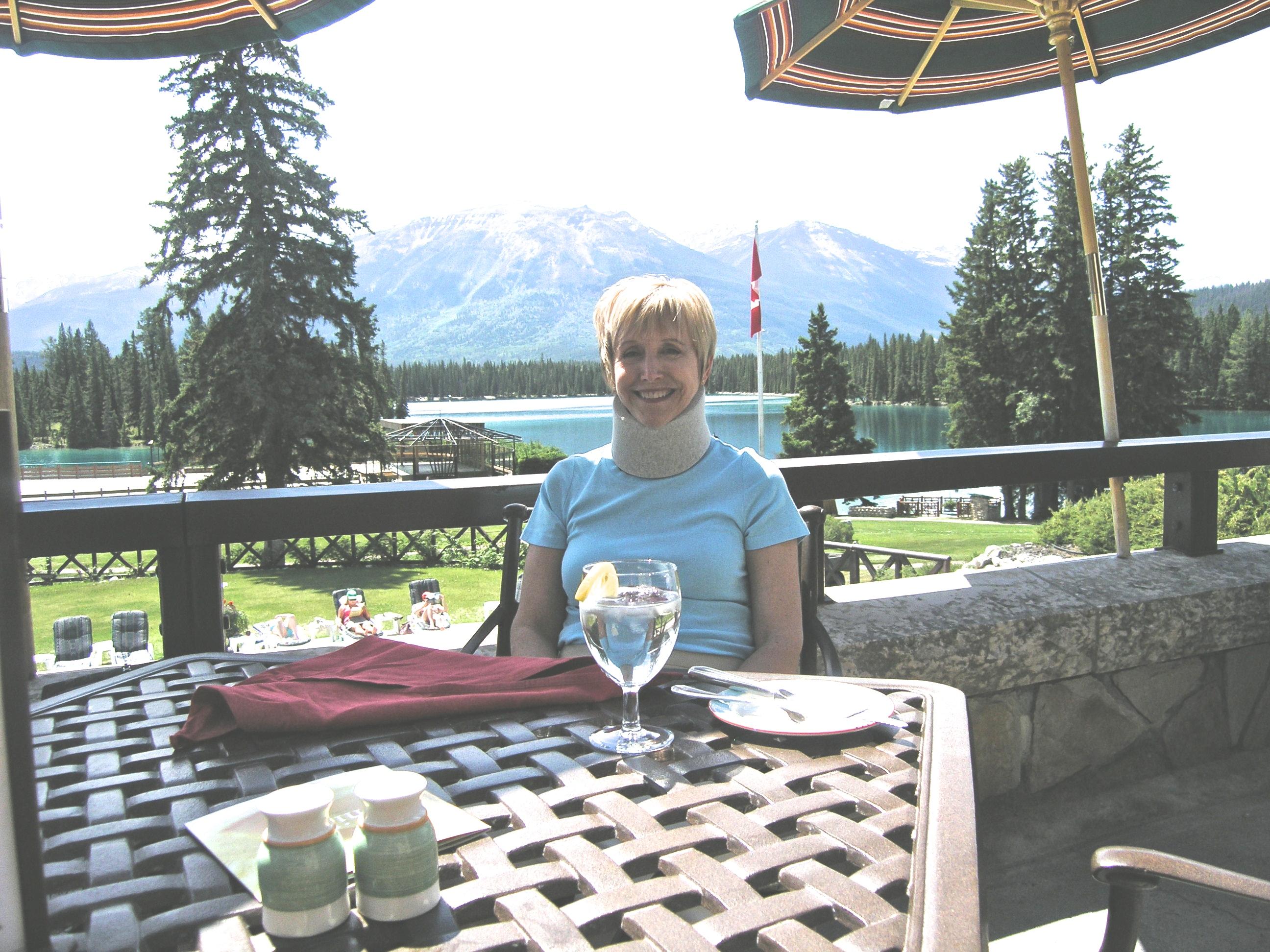 Blonde in a neck brace in Jasper Park, Canada